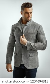 Portrait of handsome man in gray stylish jacket isoalted on white background