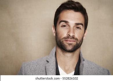 Portrait of handsome man in grey coat