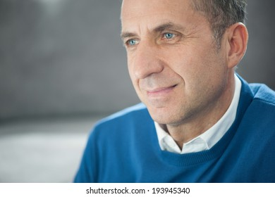 Portrait of a handsome man with grey hair