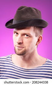 Portrait of a handsome man in hat