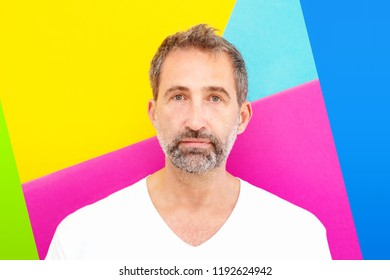 portrait of handsome man in his 50s with colorful background