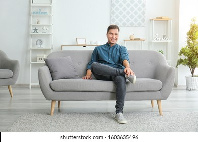 Portrait of handsome man at home
