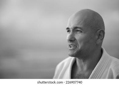Portrait of handsome man in kimono, monochrome