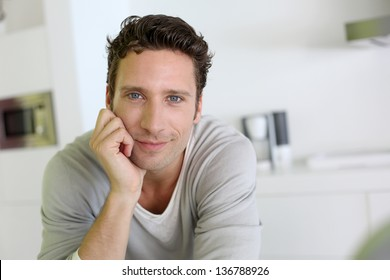 Portrait of handsome man looking at camera