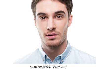 portrait of handsome man looking at camera, isolated on white