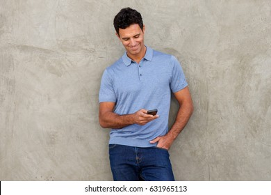 Portrait of handsome man looking at mobile phone