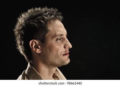 portrait of handsome man on black background