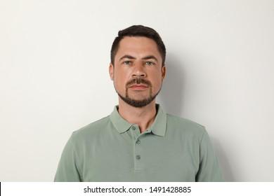 Portrait of handsome man on light background