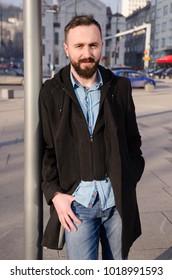 portrait of handsome  man on street