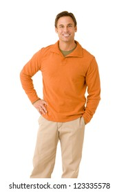 Portrait of a handsome man on a white backdrop wearing an orange sweater looking at camera