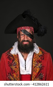 Portrait of handsome man in a pirate costume
