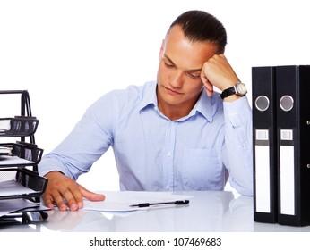 Portrait of handsome man posing in studio with office stuff