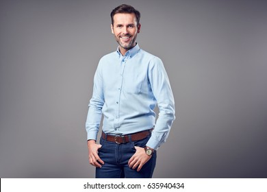 Portrait of handsome man in shirt smiling isolated