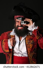 Portrait of handsome man smiles in a pirate costume