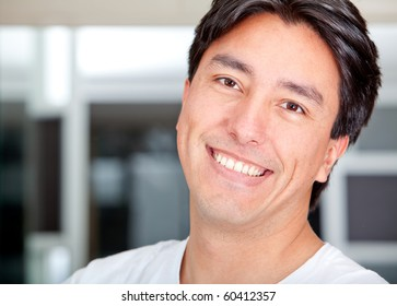 Portrait of a handsome man smiling - indoors
