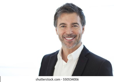 Portrait Of A Handsome Man Smiling Isolated On White