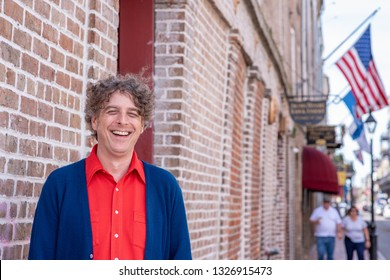 Portrait of a handsome man smiling, laughing and happy while visiting the French Quarter in New Orleans, Louisiana.