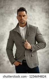 Portrait of handsome man in stylish gray jacket