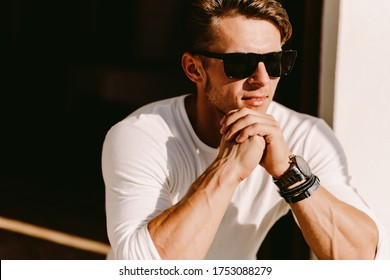 portrait of a handsome man in sunglasses and watch outdoors. Stylish man wearing casual. Men's beauty, fashion. Optics for men.