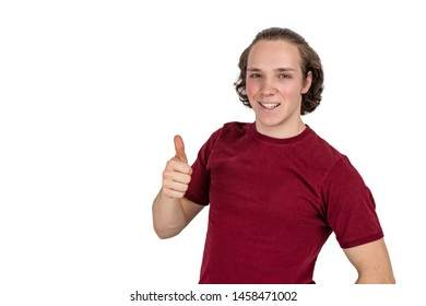 Portrait of handsome man in t-shirt smiling and showing thumbs up at camera isolated