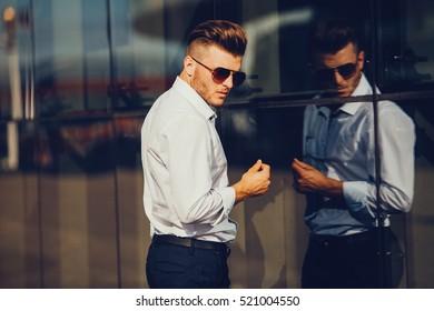 Portrait of an handsome man in an urban setting. fashion photo