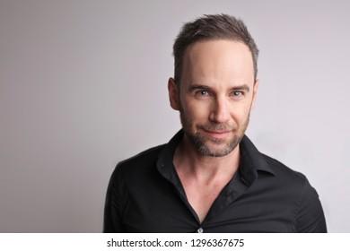Portrait of a handsome man wearing black shirt.