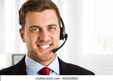 Portrait of an handsome man wearing an headset