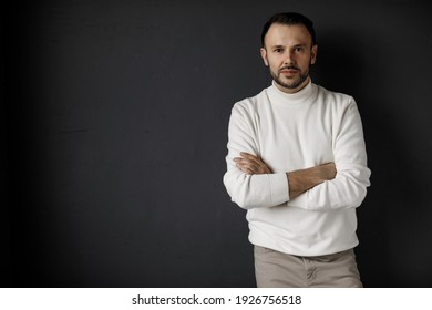 Portrait of a handsome man in white clothes indoor