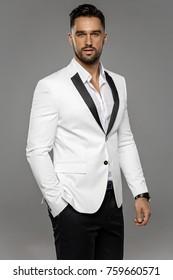 Portrait of handsome man in white jacket