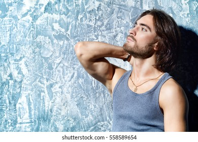 Portrait of a handsome masculine man over grunge background. Hairstyle, barbershop.