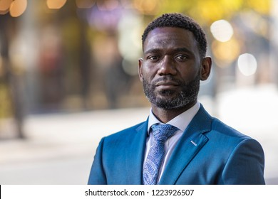 Portrait of handsome mature black male in a suit in the city