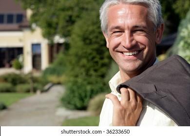 Portrait of handsome mature businessman smiling