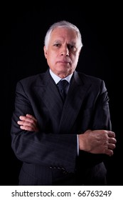Portrait of a handsome mature businessman, thinking,  on black background, studio shot