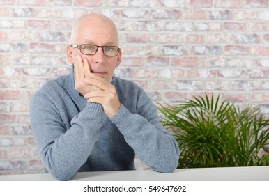 portrait of a handsome mature man with blue pullover