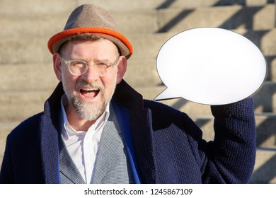 portrait of handsome mature man holding a speech bubble