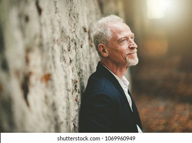 Portrait of handsome mature man, outdoors, light effect