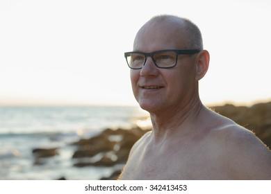Portrait of handsome mature man outdoors near beach
