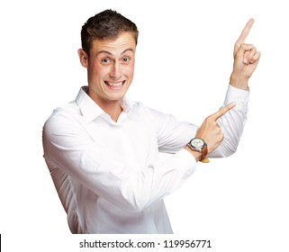 Portrait Of Handsome Mature Man Pointing Up On White Background