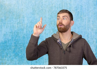 Portrait Of Handsome Mature Man Pointing Up