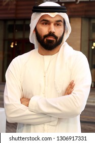 Portrait Of Handsome Middle Eastern Man Wearing Arabic Emirati Traditional Dress  ( UAE KANDORA MODEL)