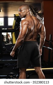 Portrait of a handsome muscular bodybuilder with muscular torso