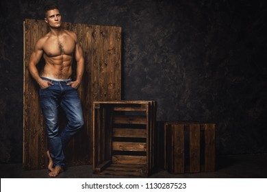 Portrait of handsome muscular and sexy man in studio