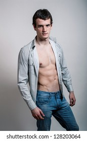 Portrait of a handsome muscular young man in shirt. Shot in a studio.