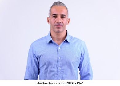 Portrait of handsome Persian businessman against white background