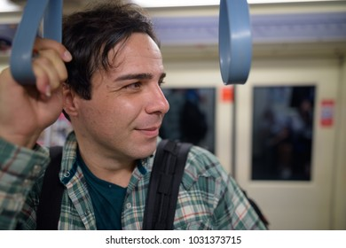 Portrait of handsome Persian tourist man exploring the city of Bangkok, Thailand