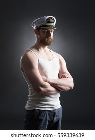 Portrait of a handsome sailor over black background.  Shipping, navigation, marine, navy concept.