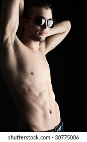 Portrait of a handsome sexual male model. Shot in a studio.