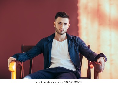 Portrait of handsome sexy man relax on sofa. Fashion portrait