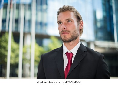 Portrait of an handsome smiling businessman