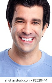 Portrait of handsome smiling man. Isolated over white background.